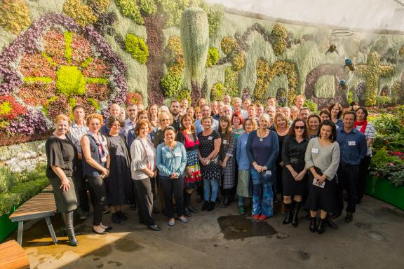 Advisory group shot with a garden backdrop